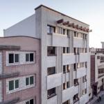 Pale brickwork creates decorative facade for Iranian apartment building