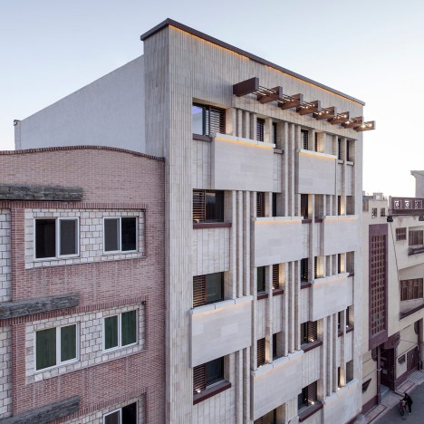 Pale brickwork creates decorative facade for Iranian apartment building