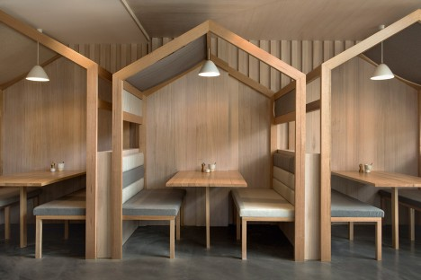 Biasol Design Studio adds booths with pitched roofs to Melbourne restaurant