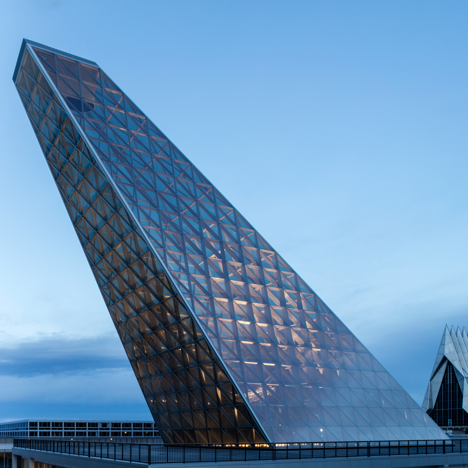 Oblique glass pyramid thrusts skyward from SOM's leadership centre at US military campus