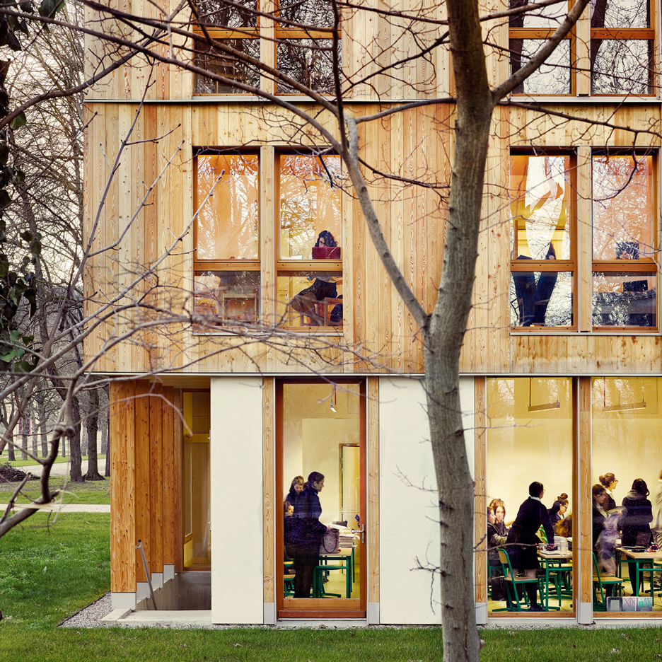 Timber and glass dormitory building nestles among trees in a Paris park