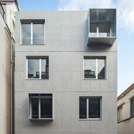 Modelia Days apartment block in Tokyo features concrete walls and steel box windows