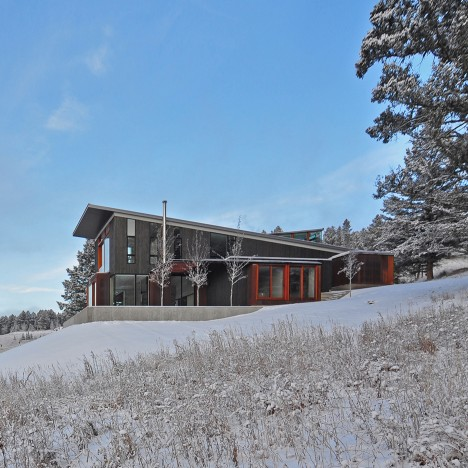 Glass observatory rises from roof of Montana mountain home by Johnsen Schmaling