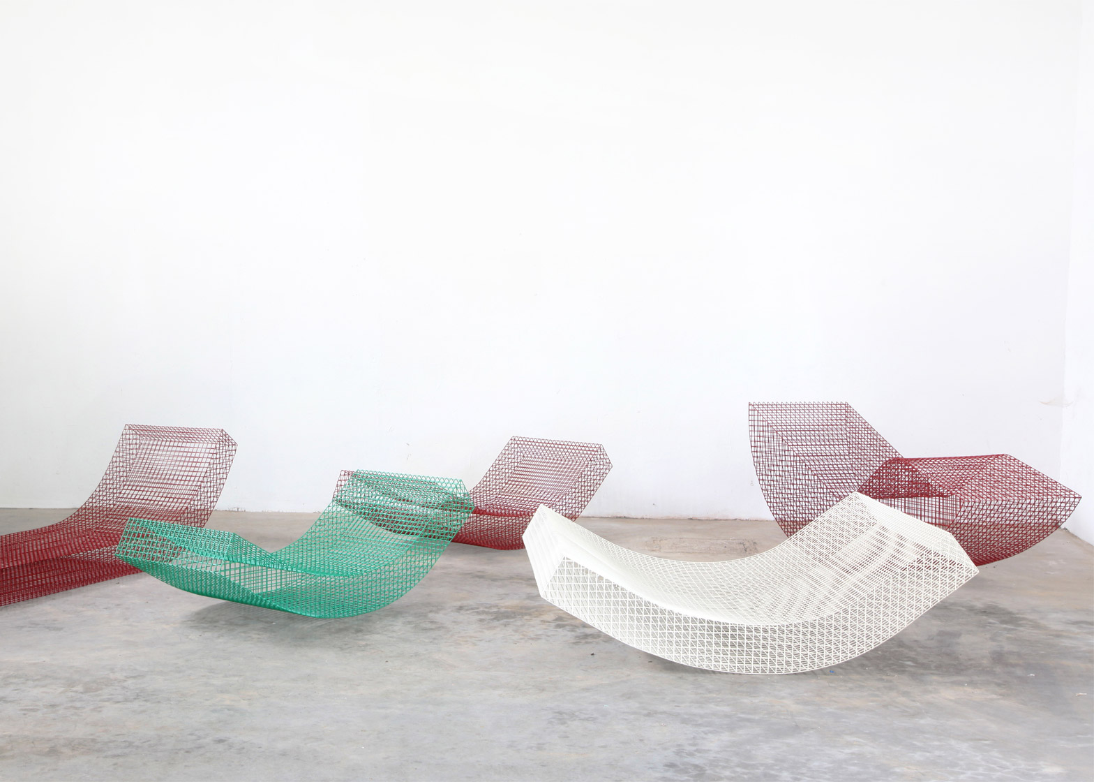 Muller van Severen designs rocking wire daybeds for Spanish summer house