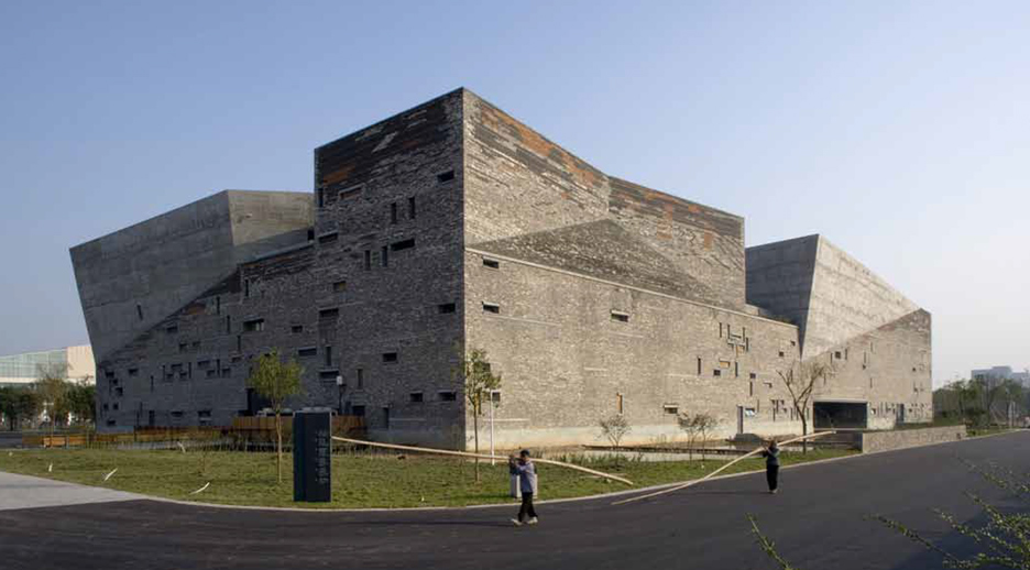 The Ningbo History Museum is one of the best-known projects by Amateur Architecture Studio, which was founded by Lu and Wang in 1997