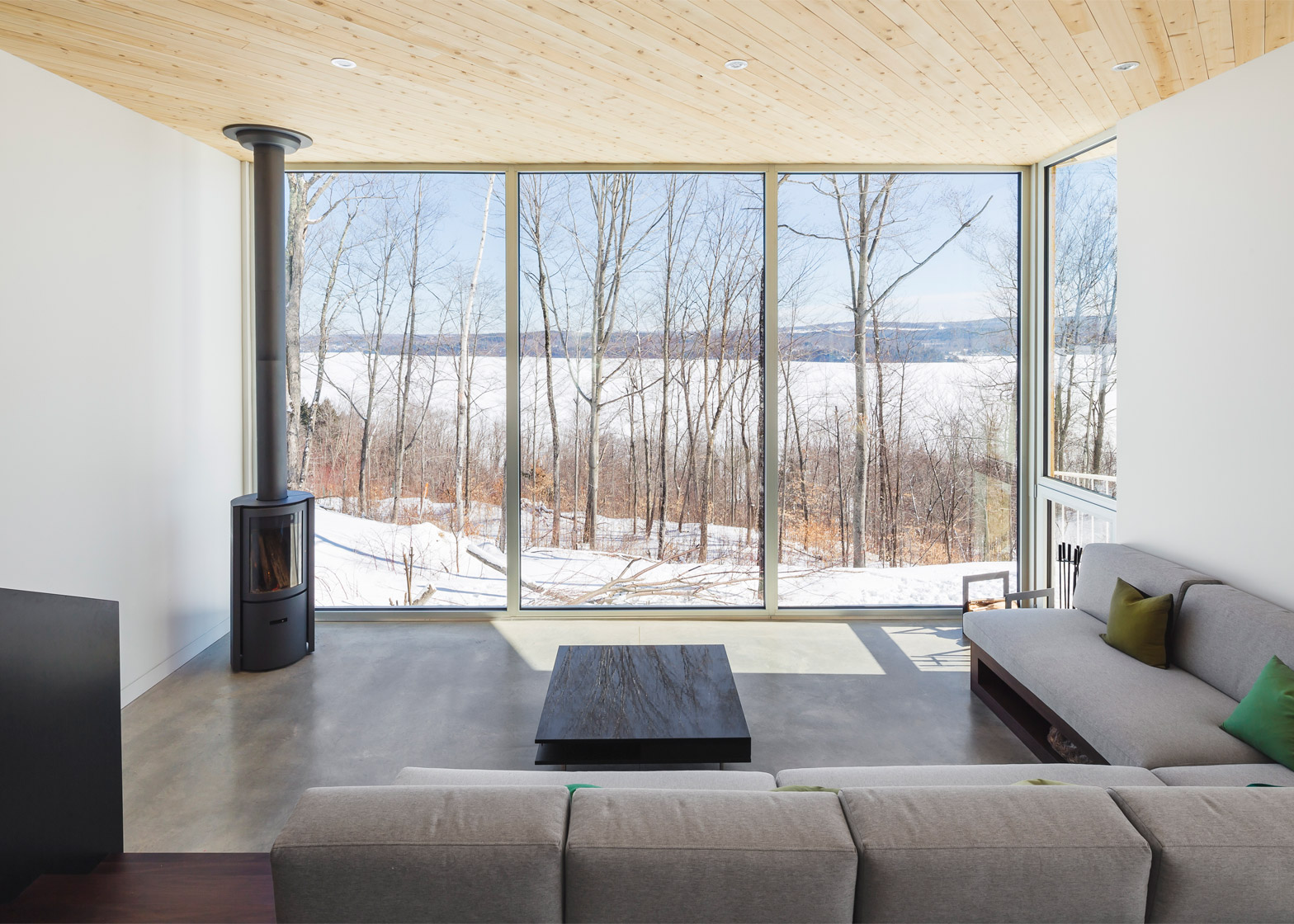 Quebec home by MU Architecture blends in with snowy terrain