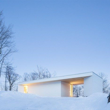 Bright white home by MU Architecture blends with Quebec's snowy landscape