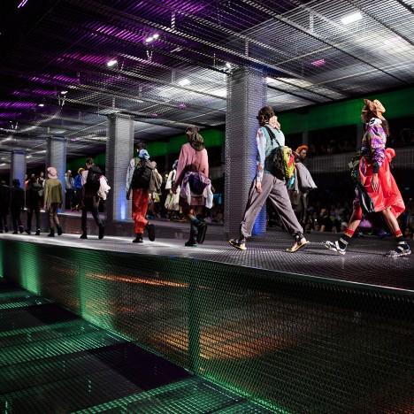 AMO installs sloping mesh catwalk for Prada fashion show