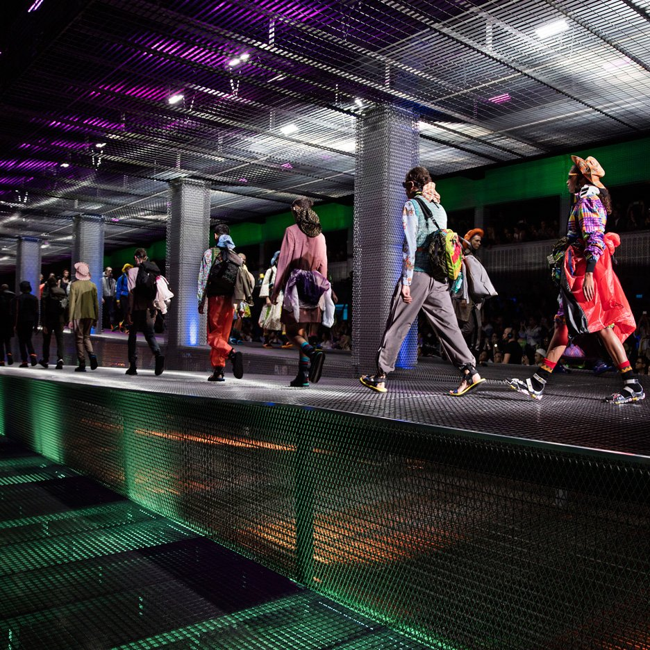 AMO installs sloping mesh catwalk for Prada fashion show