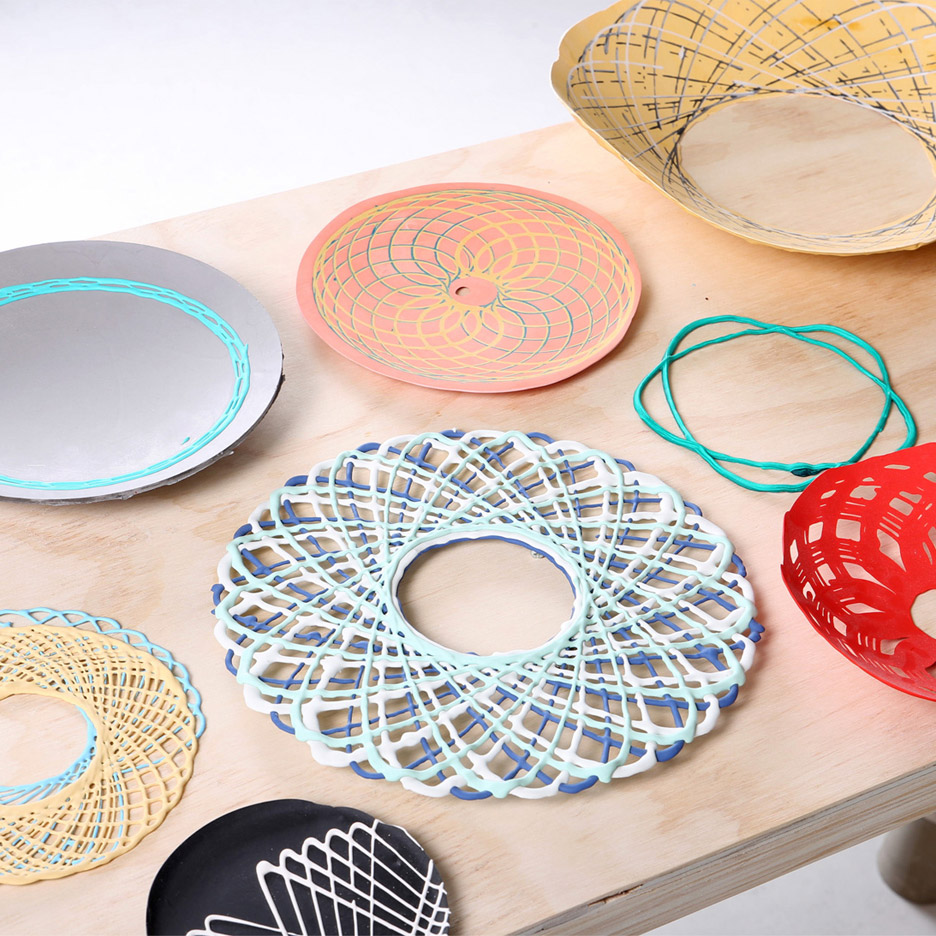 Spirograph Lab by Shawn Yang is a machine that alllows the 2D spirograph pattern to become 3D