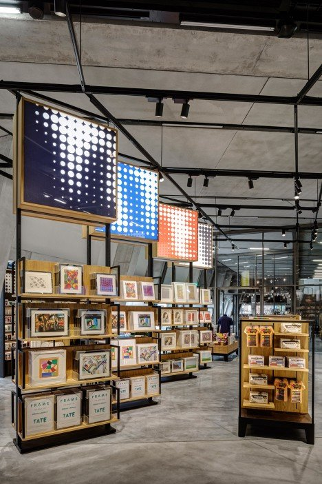 uxus designs quot permanently temporary quot gift shop for herzog de meuron s extended tate modern