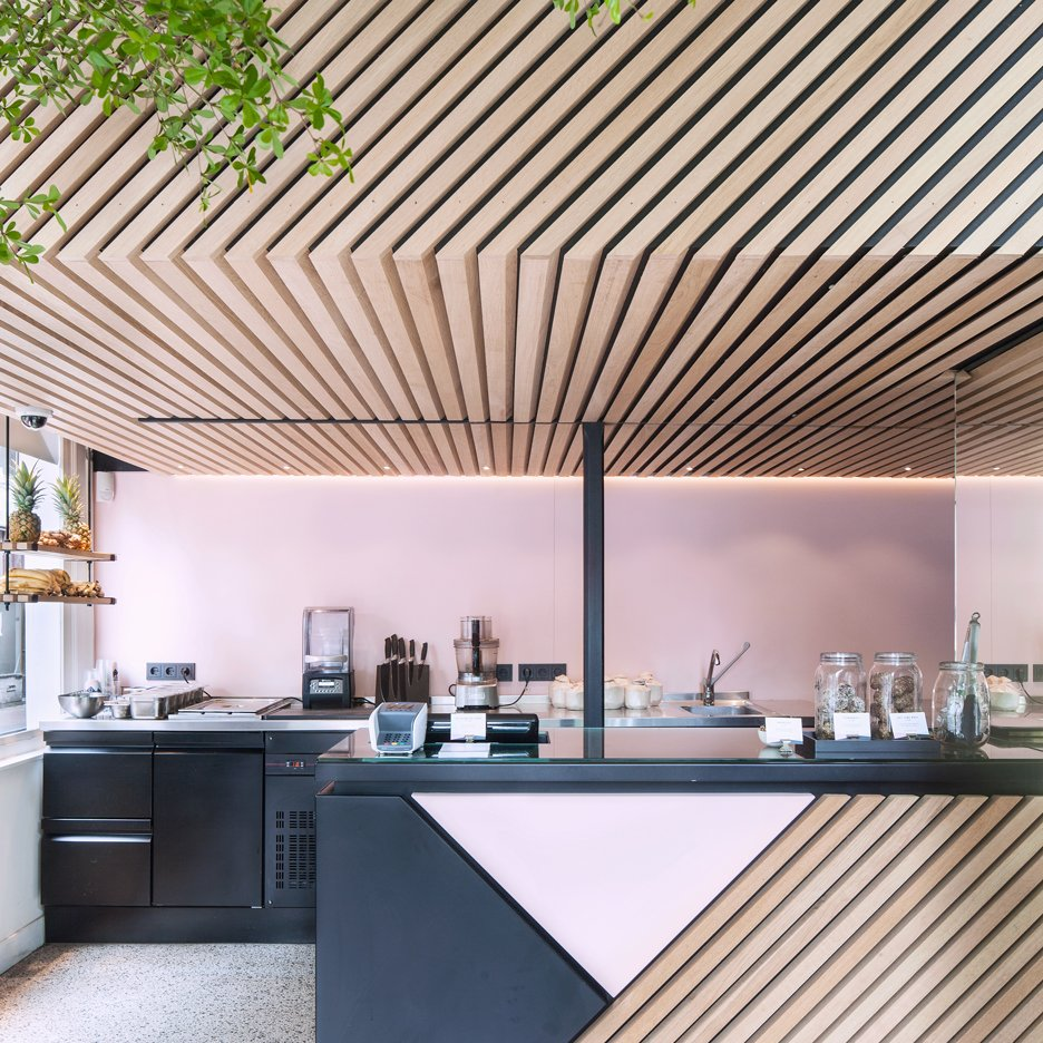 The Cold Pressed Juicery in Amsterdam designed by Standard Studio houses a living tree
