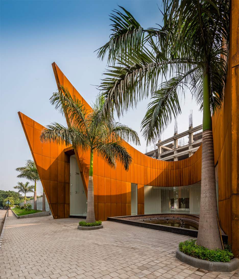 Sanjay Puri's arching office building features weathering steel facades