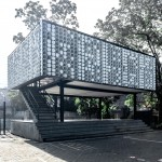 Recycled ice cream tubs cover walls of elevated Microlibrary by Shau