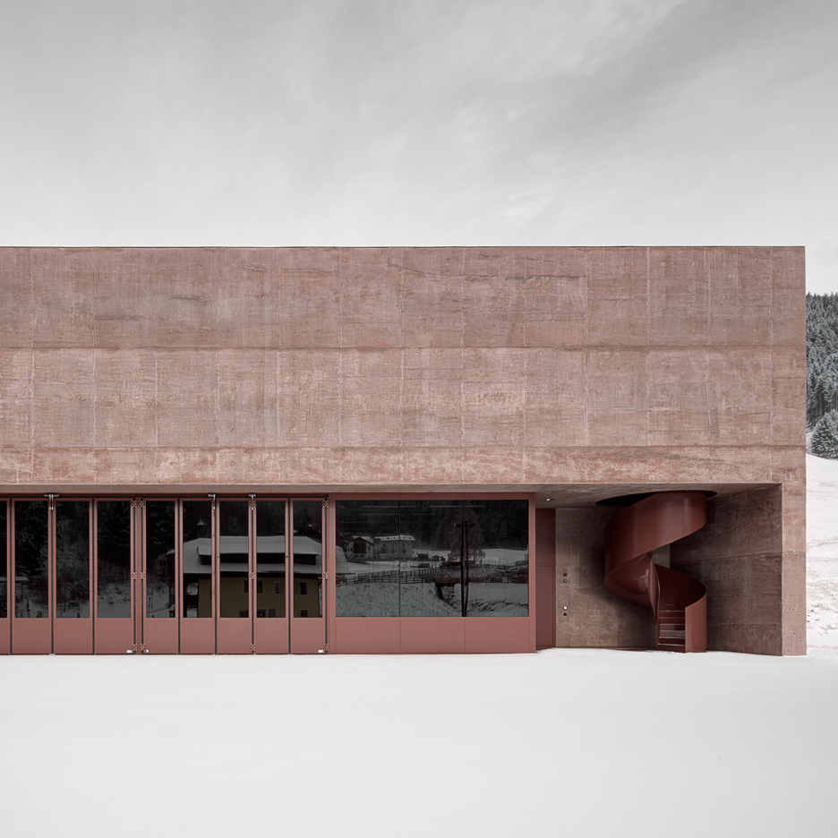 Pedevilla Architects creates rose-hued fire station for an Alpine village