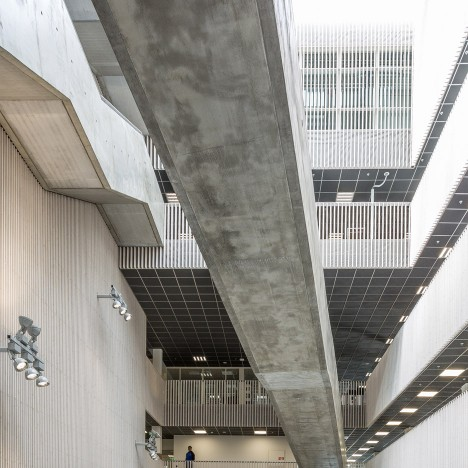 Mecanoo's KRONA centre features a light-filled atrium and zigzagging concrete staircases