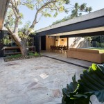 Concrete home in Argentina is arranged around mature trees and plunge pool