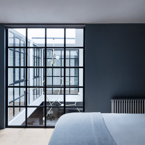 Paper House Project inserts gridded glass atrium into London warehouse home