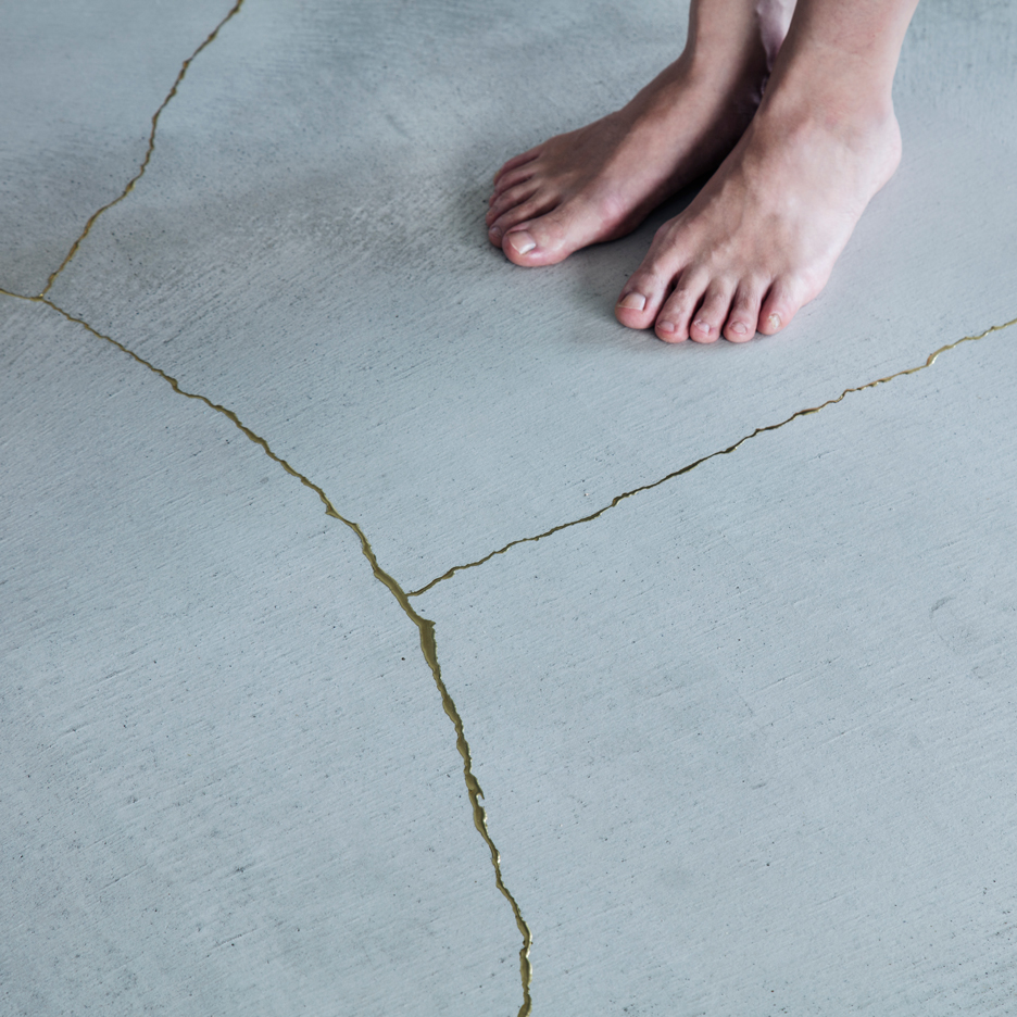 Golden resin highlights cracks in the floor of TANK's Xchange Apartment