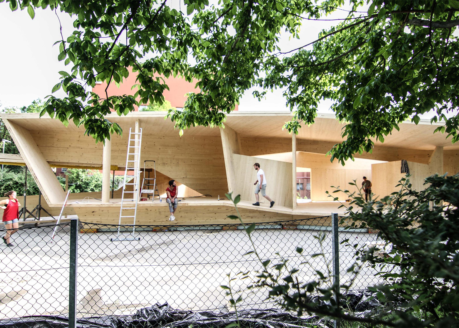 Bilding is a faceted wooden community centre built by students