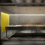 Yota Kakuda creates tiled interior for cheese tart store in Japan