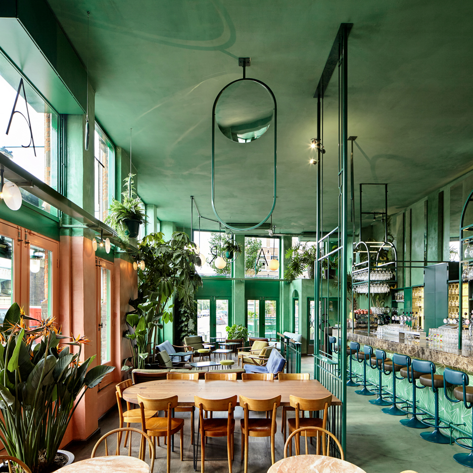 Rainforest foliage and mirrors feature inside Amsterdam bar by Studio  Modijefsky
