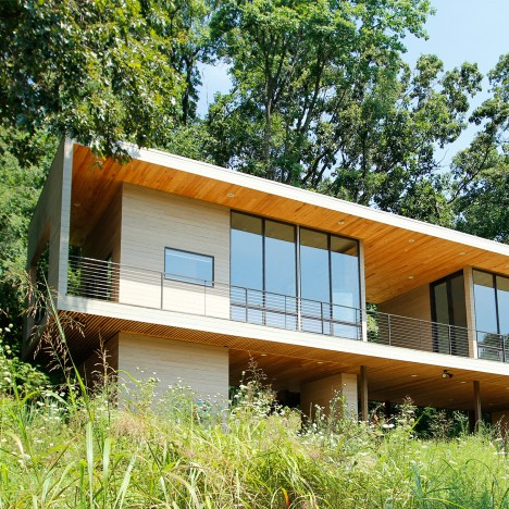 Studio building by Hanrahan Meyers rises up from a forested hillside in Pennsylvania