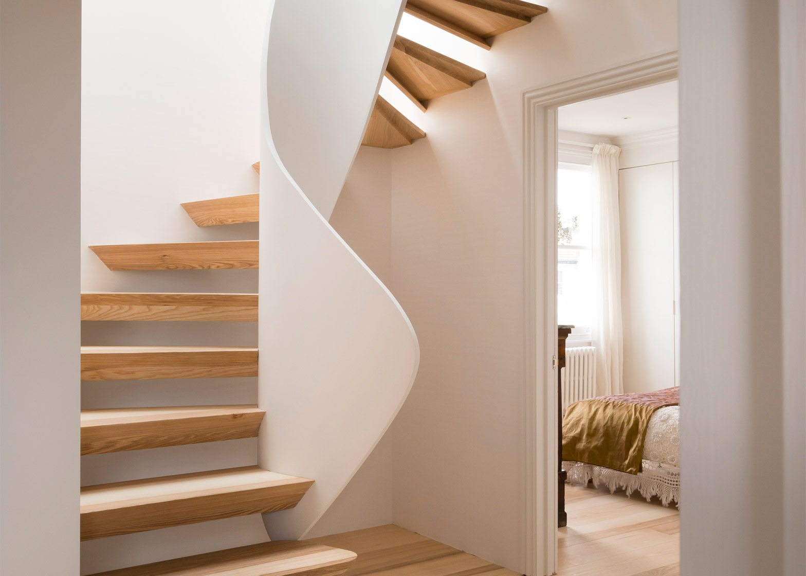 Twisted staircase features in Casa Vota renovation by 51 Architecture