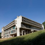 Le Corbusier's La Tourette monastery combines grass-covered roofs with sloping glazed corridors