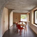 "Freiluft uses concrete ""tree"" to form rooms within Swiss barn conversion"
