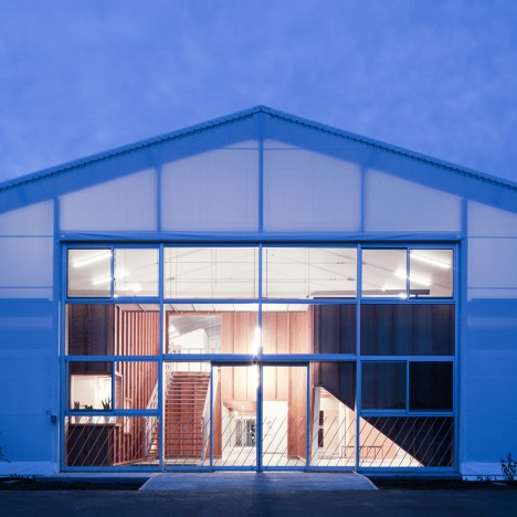 Yasutaka Yoshimura wraps warehouse in tent fabric to create Fukumasu Base kindergarten