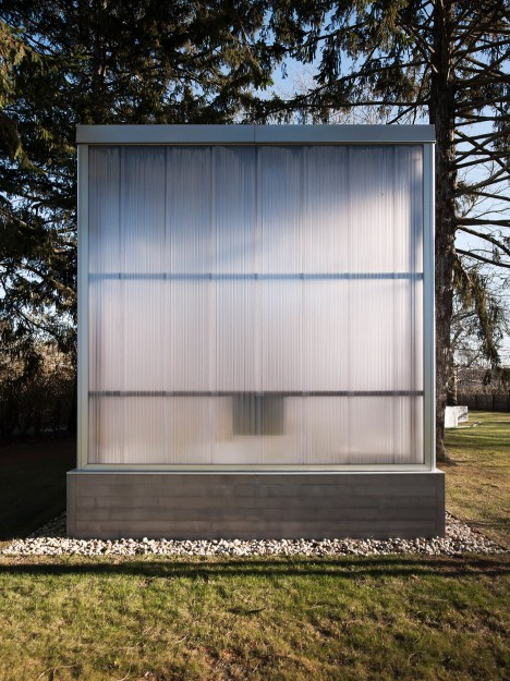 TBD uses contrasting materials to define his-and-hers art studio in the Hamptons