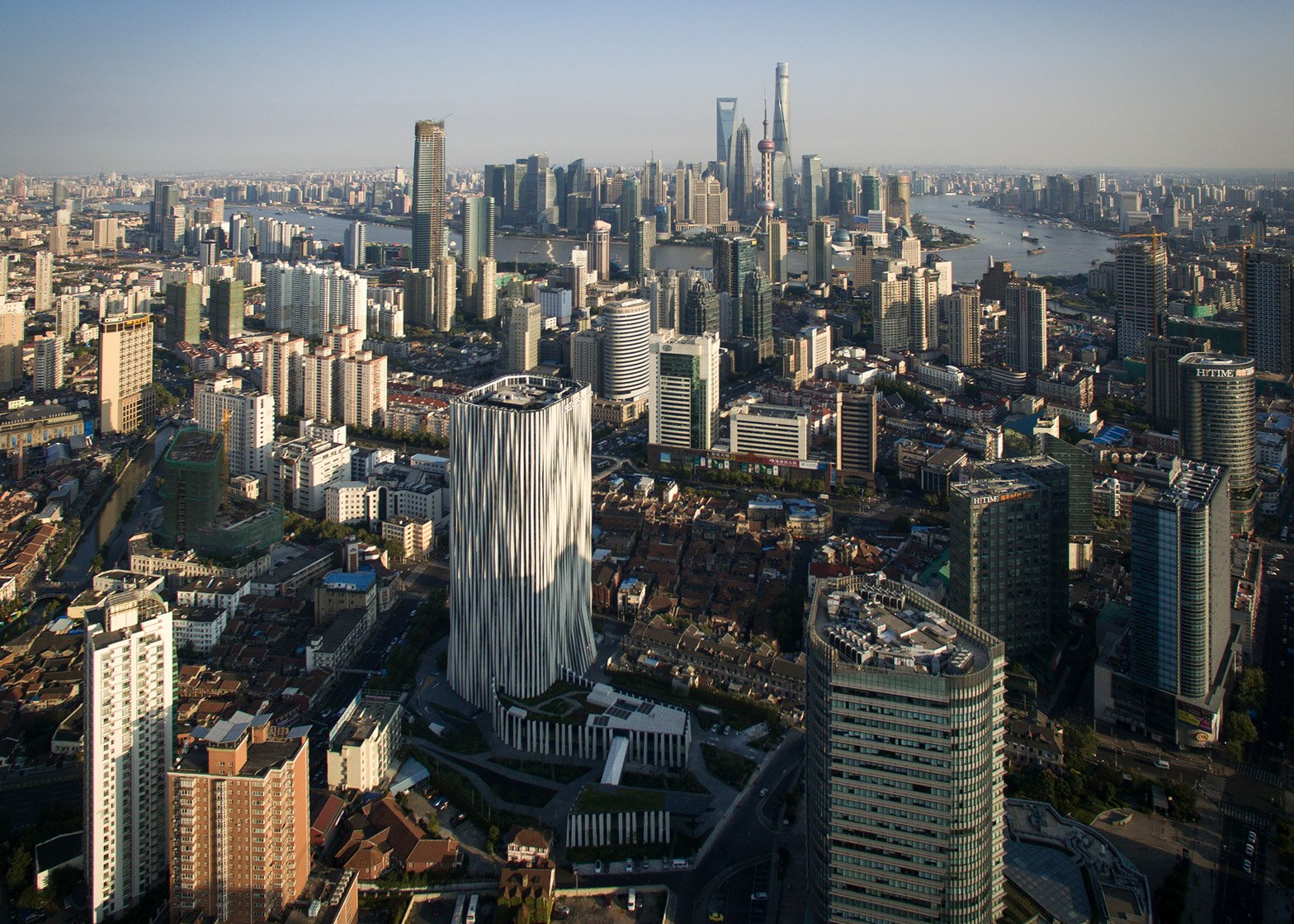 Strips of pleated aluminium are added to the facade of this Shanghai tower by Kengo Kuma