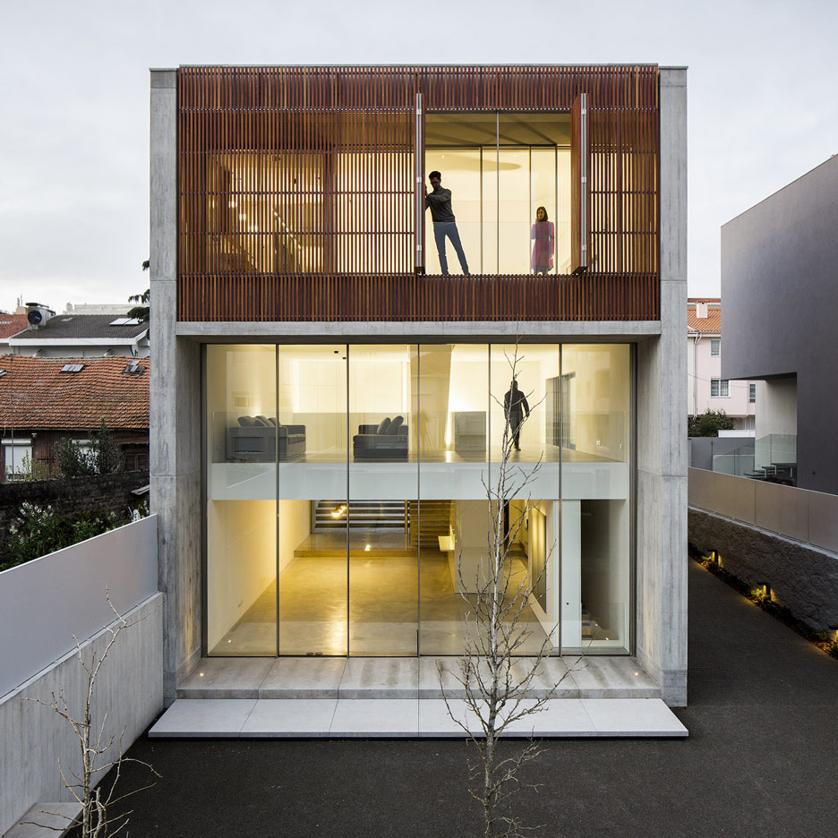 AZO Sequeira mask glazed walls with wooden screens in this house in Porto