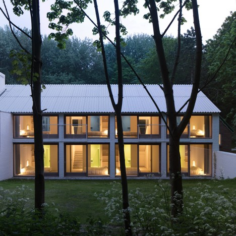 Cluster of gabled blocks form forest holiday home by Studio Nauta