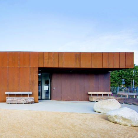 ABK updates 1960s leisure centre with new Corten-steel facade