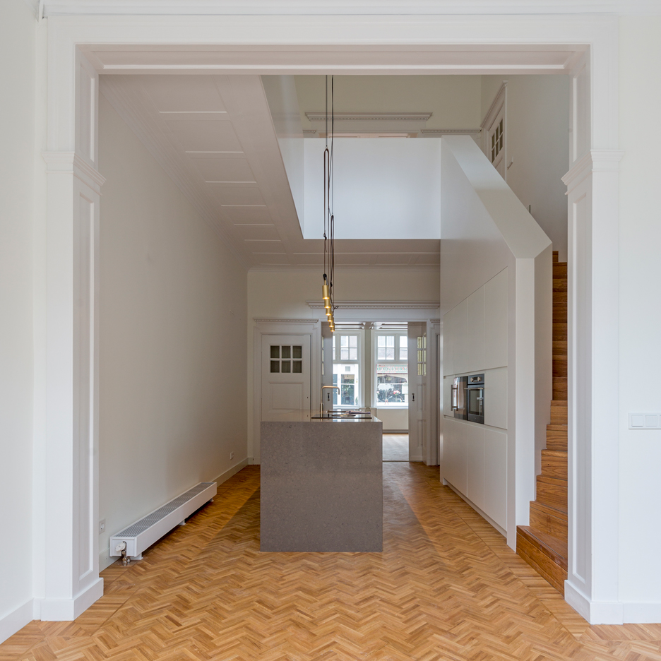 Antonia Reif updates Dutch townhouse with herringbone parquet and chevron-patterned tiles