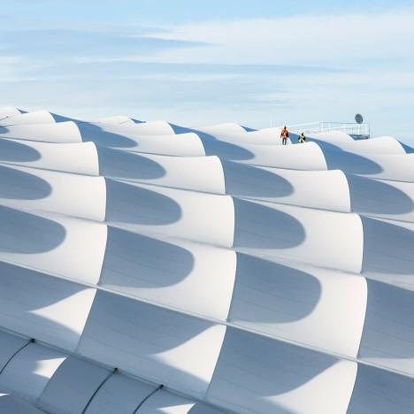 SCAU adds undulating ring-shaped roof to Marseille football stadium