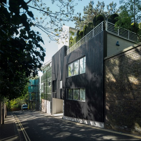 Denizen Works adds burnt wood cladding to Modernist house in London's Highgate