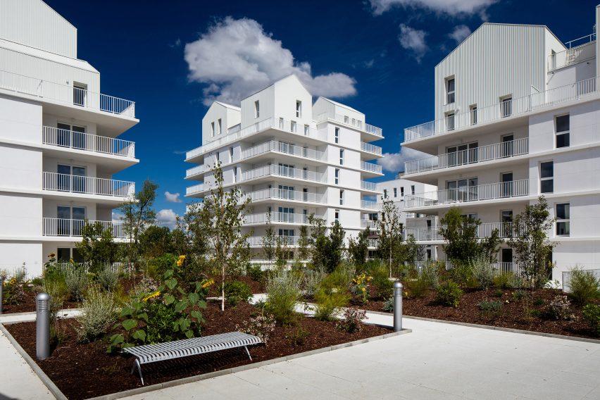 Gabled penthouses sit atop apartment blocks at Bordeaux housing scheme