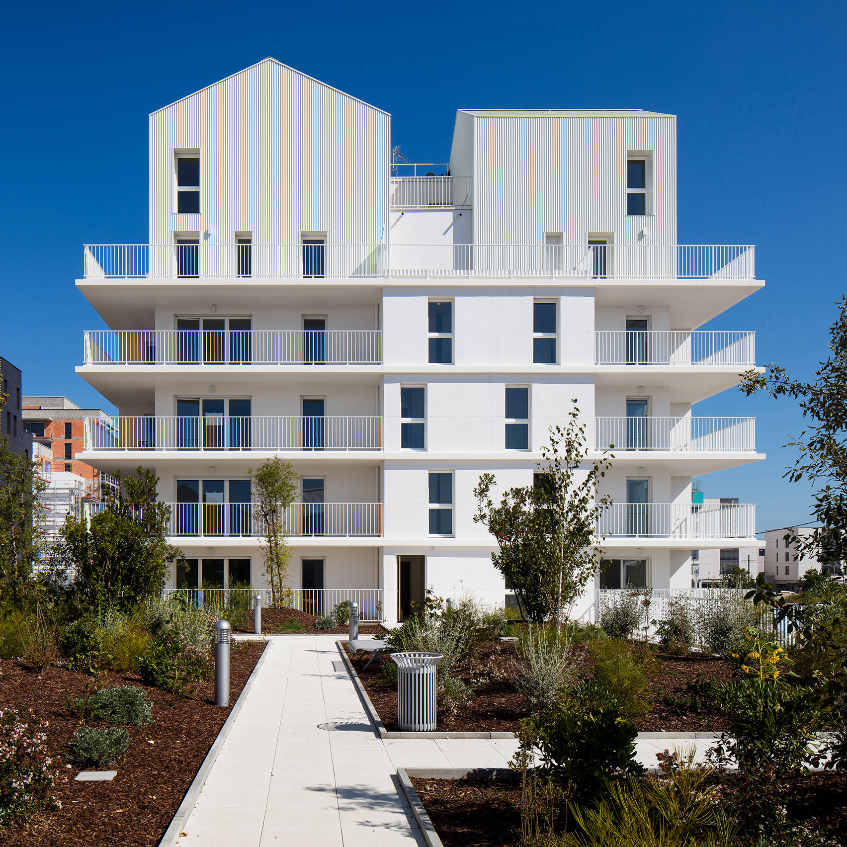 Apartment Block: 3Novices:White Latticework Covers Parisian Apartment Block