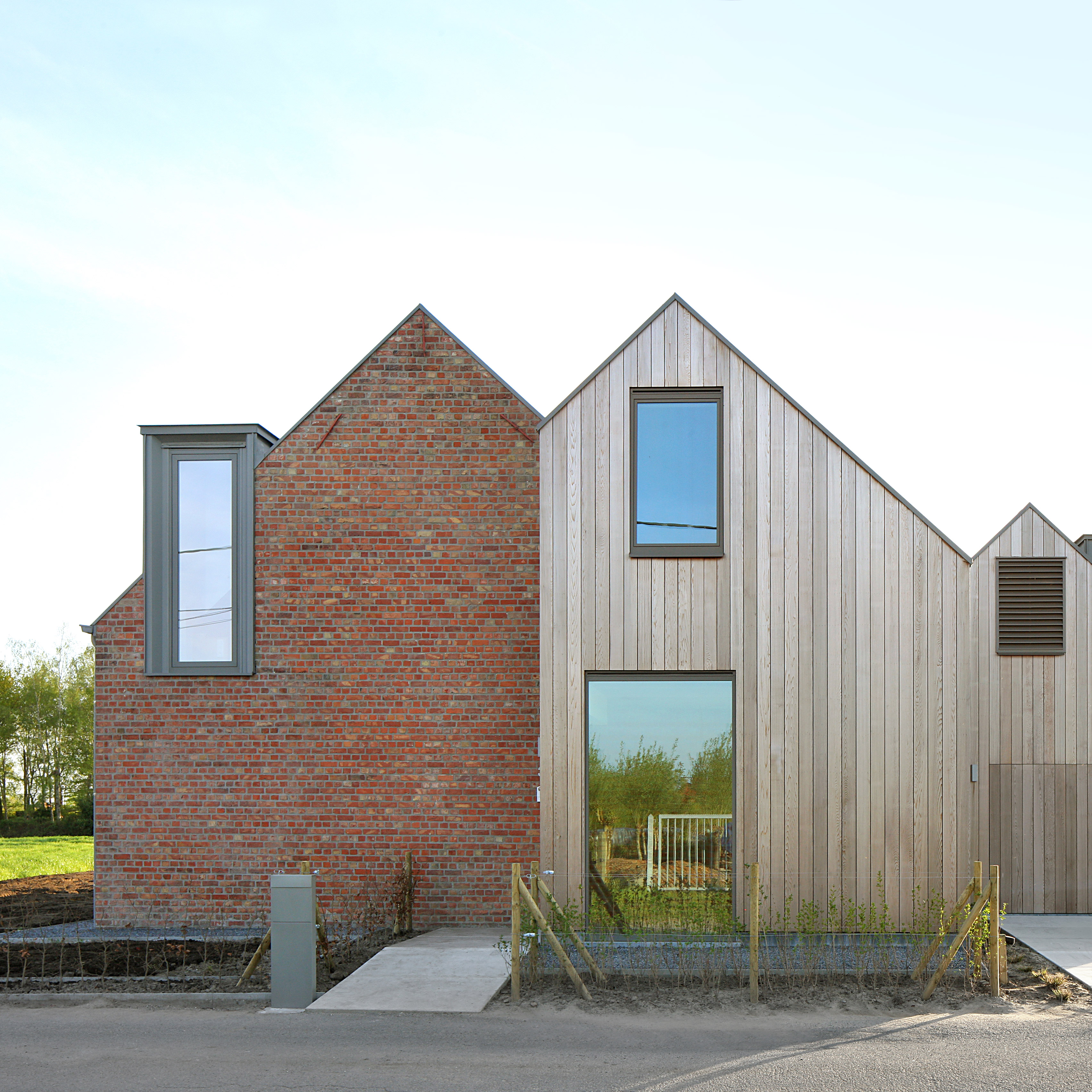 Atelier tom vanhee adds pair of gabled extensions to brick farmhouse in belgium architecture - Small belgian houses brick ...