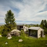 Carney Logan Burke builds Wyoming retreat around huge boulder