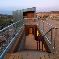 Gabion cages filled with volcanic stone support meditation platform at Utah spiritual retreat