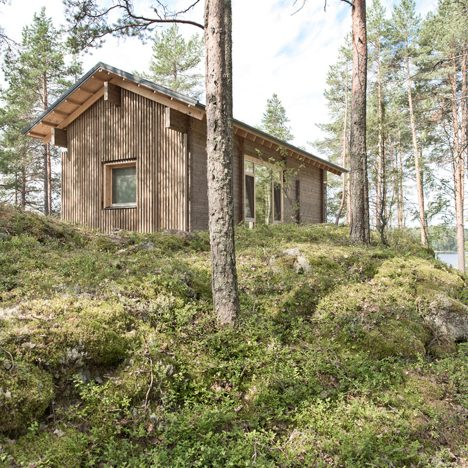 Lake cabin by Sini Kamppari features slatted timber walls and a projecting terrace