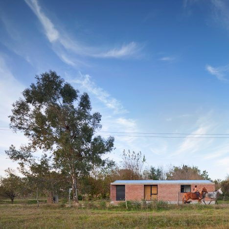 Casa Bovero by Germán Müller is a house among eucalyptus trees in rural Argentina
