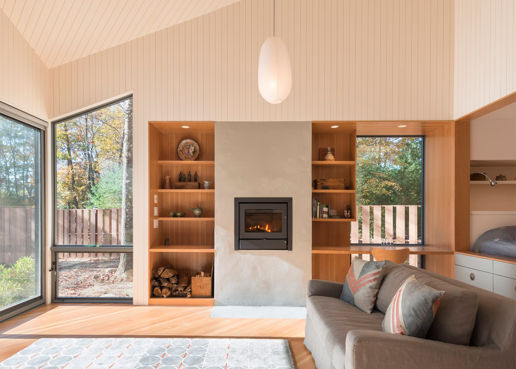 Cottage in woods by 3six0 Architecture