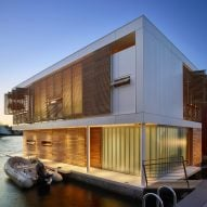 Floating home in Seattle by Vandeventer + Carlander features water-level bedrooms