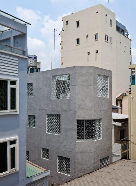 Hem House by Sanuki Daisuke features patterned window grilles and a hidden roof garden
