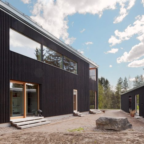House H by Teemu Hirvilammi features a black exterior and pale wood interior